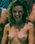 Kylie Minogue nude in topless at the beach - young