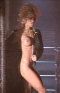Pamela Anderson nude in Barb Wire