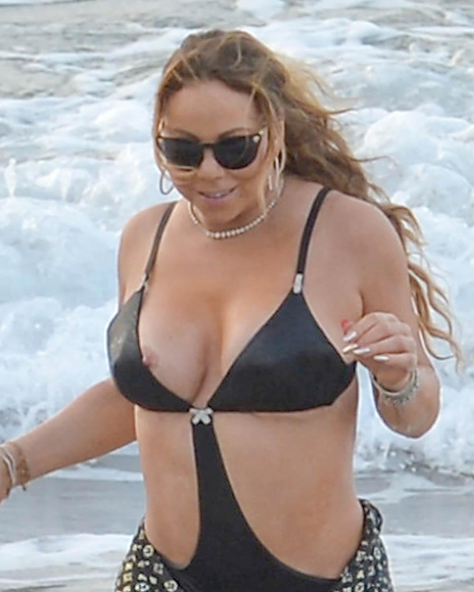 Braless Mariah Carey's Boobs Look Fit To Pop In Cleavage